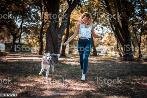 Happy woman running in park with her husky dog picture id1175013654?b=1&k=6&m=1175013654&s=612x612&h=e9tniwf5qfx4fxnnjpp8oy5tspkizoza octvvwgfwa=