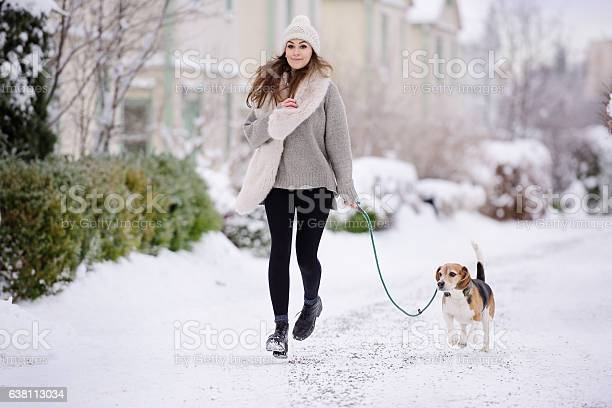 Happy woman running with beagle dog on winter street picture id638113034?b=1&k=6&m=638113034&s=612x612&h=cf8deyuifymlht8knv4n3qgkase0uiix ddirxrib7s=