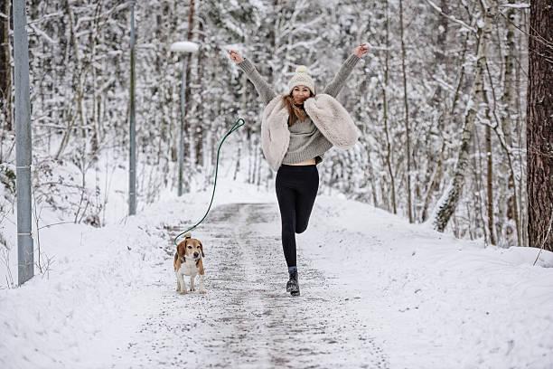 Happy woman running with beagle dog on winter walk path picture id638108062?b=1&k=6&m=638108062&s=612x612&w=0&h=1co4dkhtefjxak63nga0ortdfwgvq 4pkmj0kbz76f0=