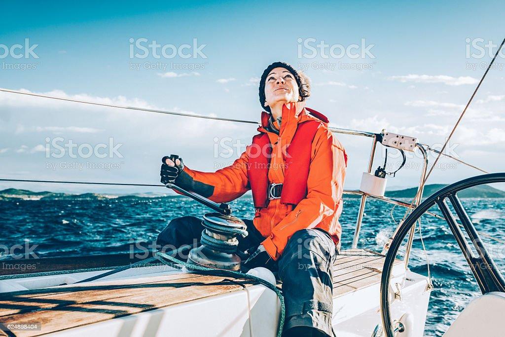 Happy woman sailing during regatta stock photo