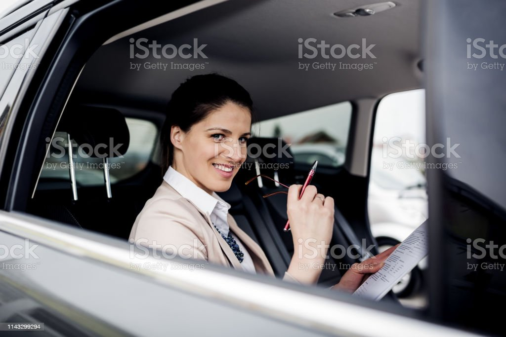 Happy woman saleing cars royalty-free stock photo