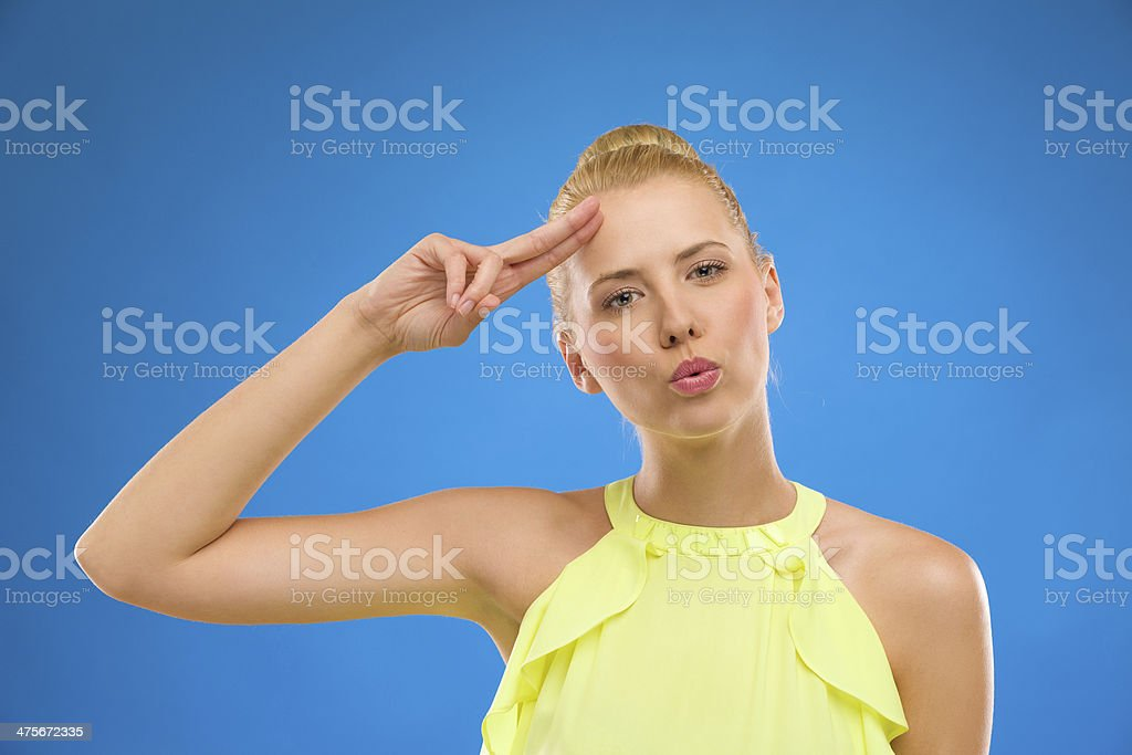 Happy woman saluting and whistling royalty-free stock photo