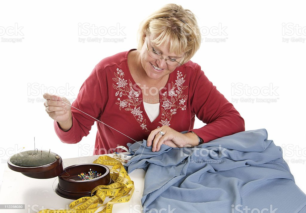 Happy Woman Sewing royalty-free stock photo