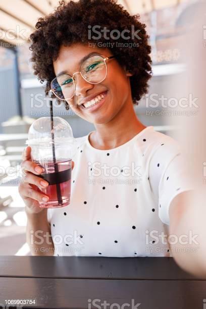 Happy woman shooting selfie on her mobile phone picture id1069903754?b=1&k=6&m=1069903754&s=612x612&h=kkosisvsdjr599q npvrdkmxwiblijnuioi9ugnrxj8=