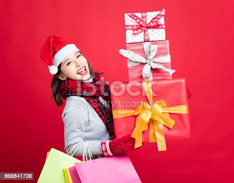istock happy Woman shopping for christmas gifts 866841706
