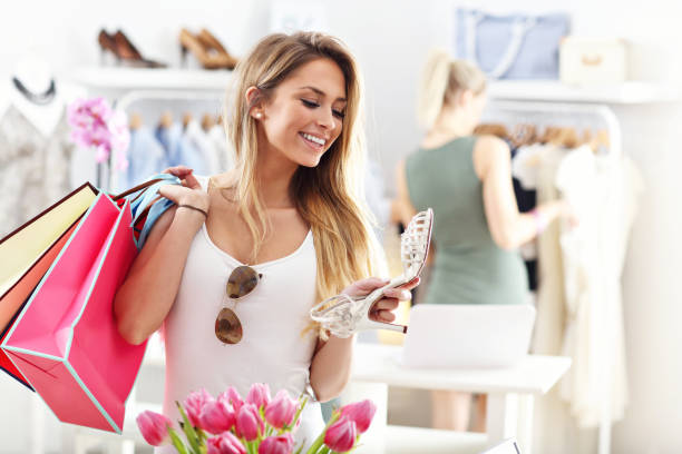 Happy woman shopping for shoes stock photo