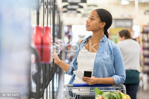 istock Happy woman shopping in frozen food section 917911472