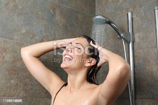 Happy woman showering and singing