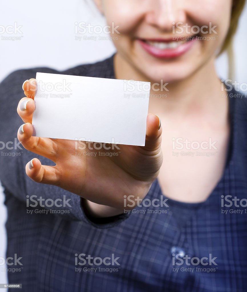 Happy woman showing blank business card royalty-free stock photo