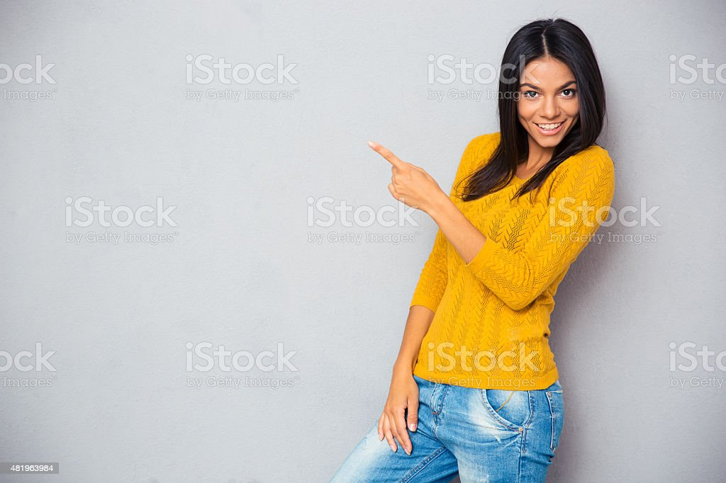 Happy woman showing finger away stock photo