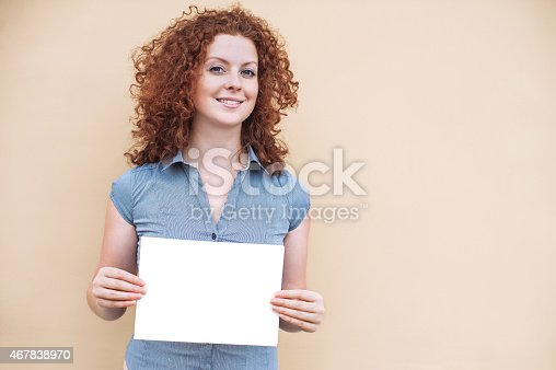 istock Happy woman showing white banner 467838970