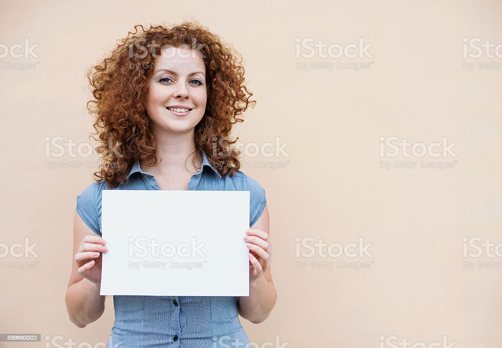 Happy woman showing white banner royalty-free stock photo