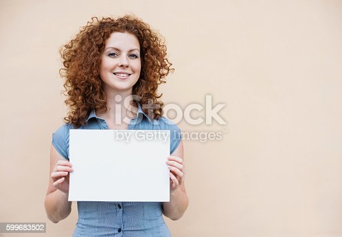 istock Happy woman showing white banner 599683502