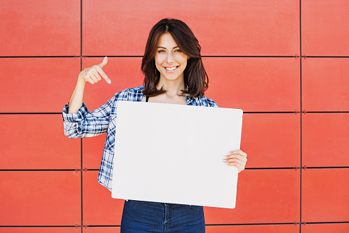 istock Happy woman showing white banner 603319724