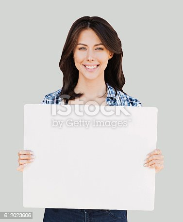 istock Happy woman showing white banner 612023606