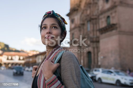istock Happy woman sightseeing around Cusco around the Cathedral 1324227698