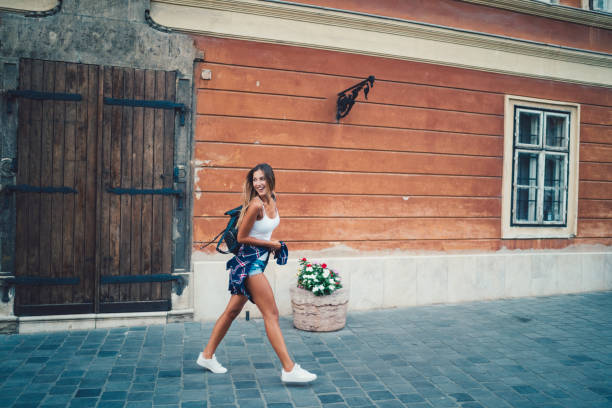 happy woman sightseeing in europe - charming stock photos and pictures