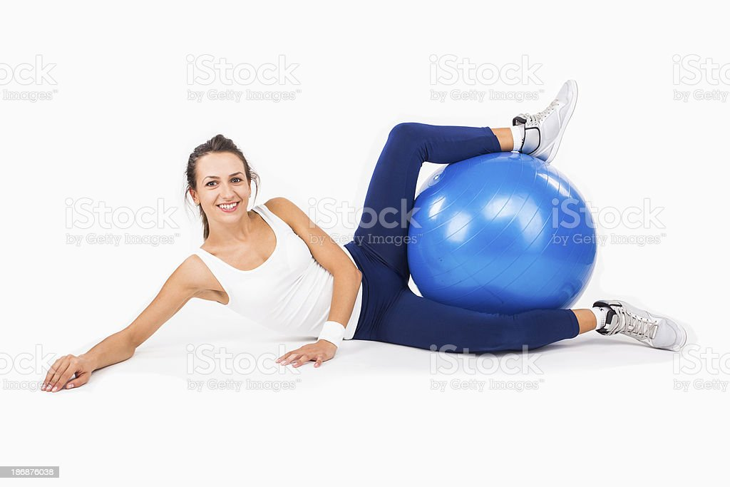Happy woman sitting on floor with fit ball royalty-free stock photo