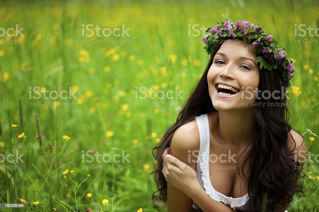 Happy Woman sitting On Grass royalty-free stock photo