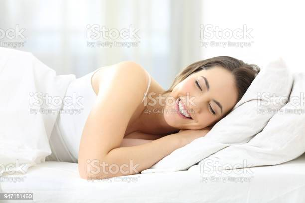 Happy woman sleeping comfortable in a bed picture id947181460?b=1&k=6&m=947181460&s=612x612&h=pwj5odtczkfu9m edygtsz dwnx6wxpla5k2yeol4xi=