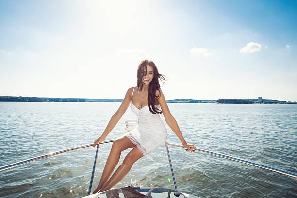happy  woman smiling on boat stock photo