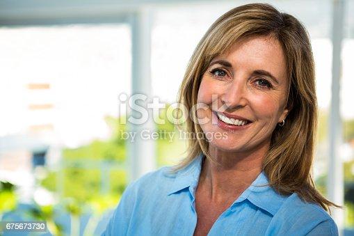 istock happy woman smiling 675673730
