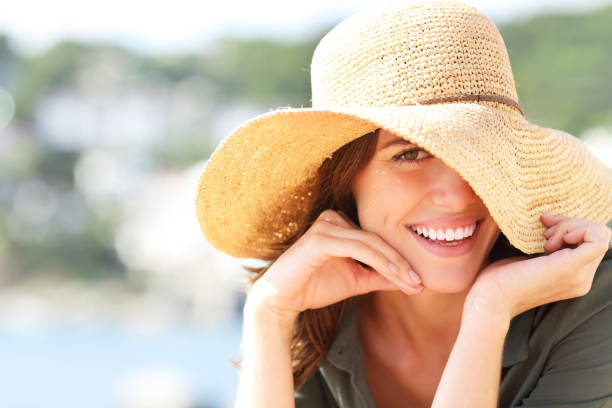 Happy woman smiling with perfect teeth on vacation stock photo