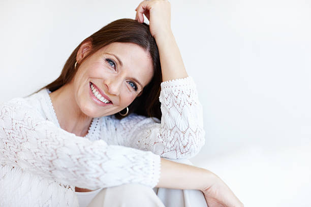 Happy woman spending time at home Closeup portrait of happy woman spending time at home only mature women stock pictures, royalty-free photos & images