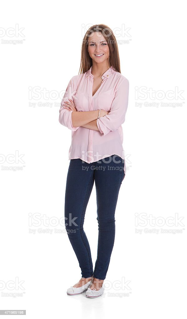 Happy Woman Standing Arms Crossed Over White Background stock photo