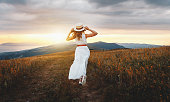 istock Happy woman standing with her back on sunset in nature 1174879951