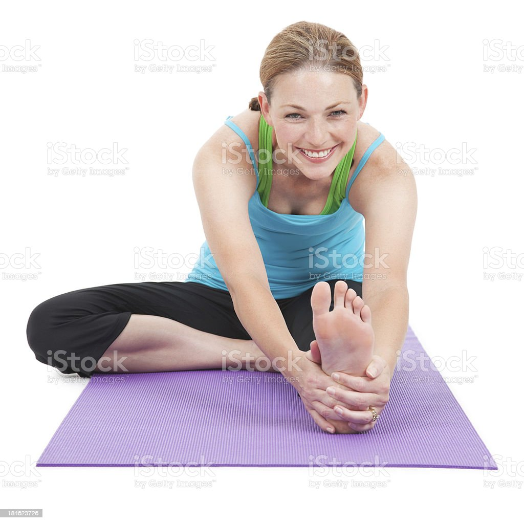 Happy Woman Stretching Her Legs Out Forward royalty-free stock photo