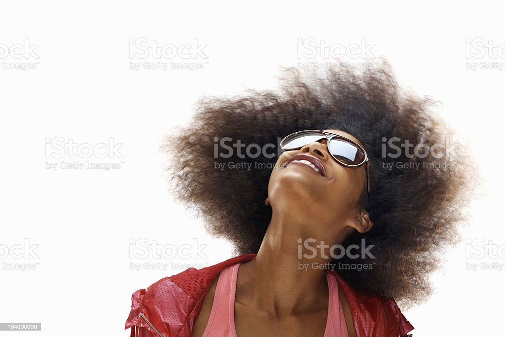 Happy woman swaying her hair on white background stock photo