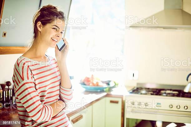 Happy woman talking on smart phone in kitchen picture id591817474?b=1&k=6&m=591817474&s=612x612&h=8y5u9fy4906alf1lhdygyldqwehcrcajg8ia0ftgji0=