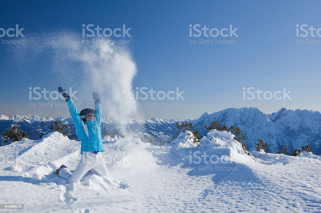 happy woman throwing snow royalty-free stock photo