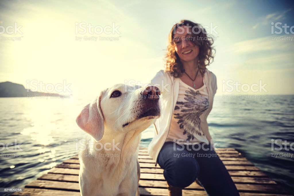 happy woman to have fun together with her dog stock photo