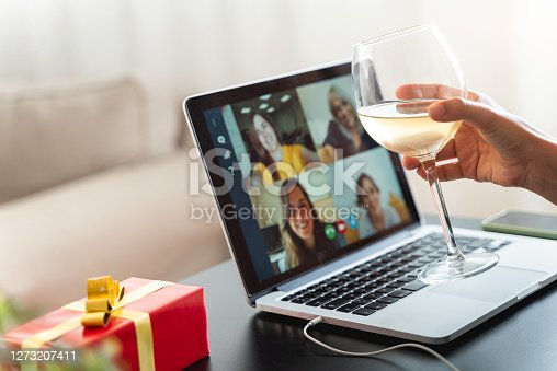 istock Happy woman toasting and celebrating birthday online during coronavirus outbreak - Focus on wine glass 1273207411