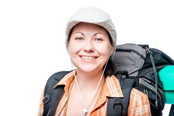 happy woman tourist with a backpack on a white background stock photo