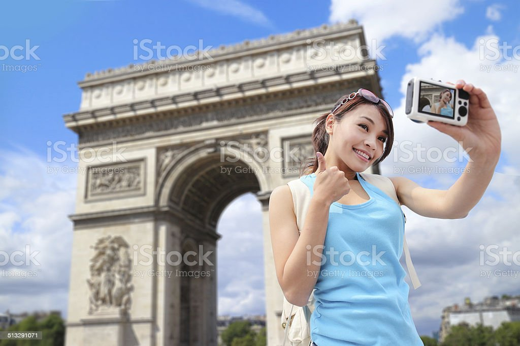 Happy woman travel in Paris stock photo
