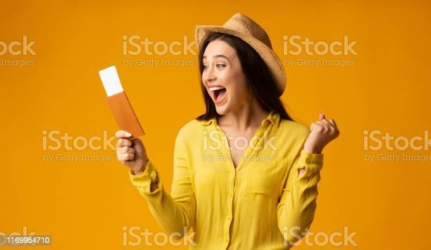 Happy woman traveler holding tickets and passport studio shot picture id1169954710?b=1&k=6&m=1169954710&s=612x612&h=wqheseopmqbn3t8faio6itxtbivni2kcme tgeuxr7w=