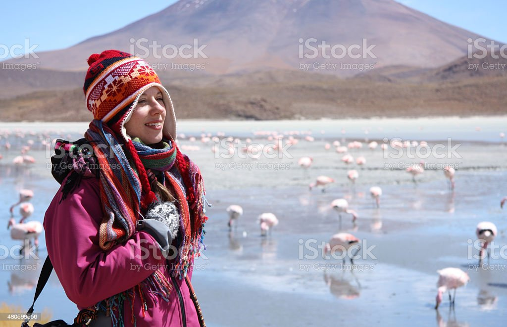 Happy woman travels in wild nature of Andes, Bolivia stock photo