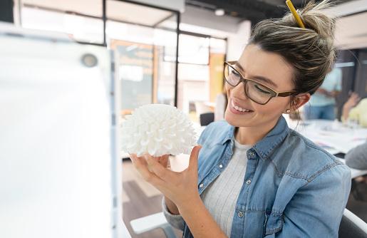 istock Happy woman using a 3D printer 1021334512