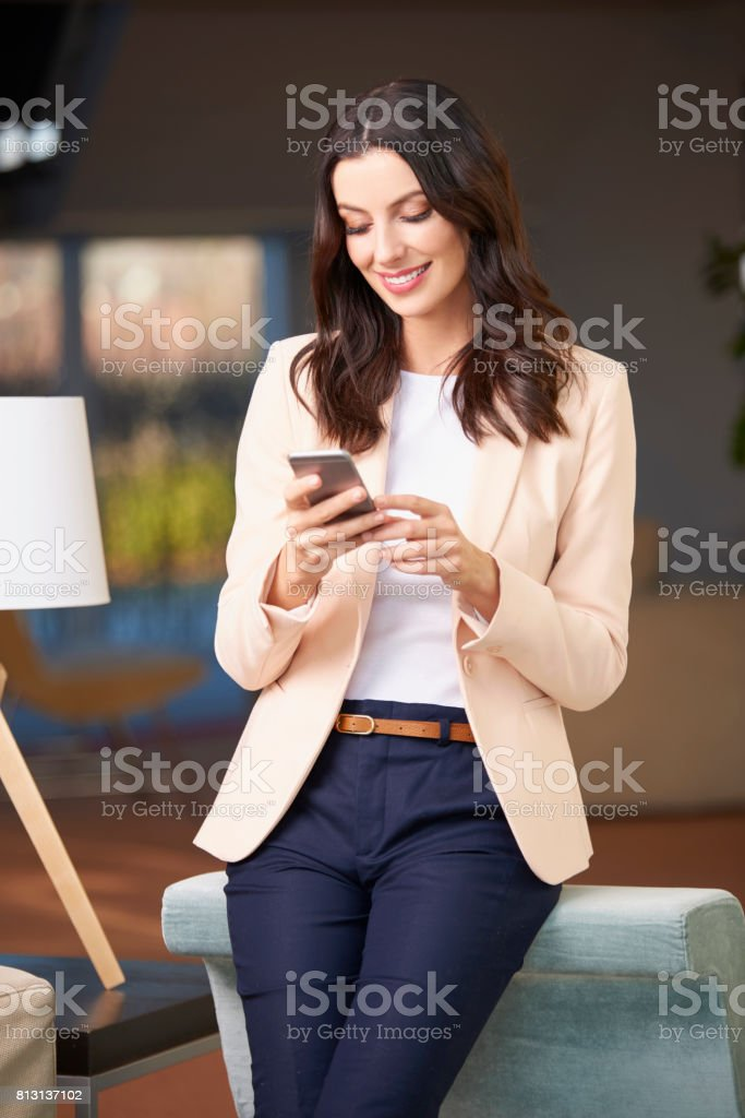Happy woman using her cellpone stock photo