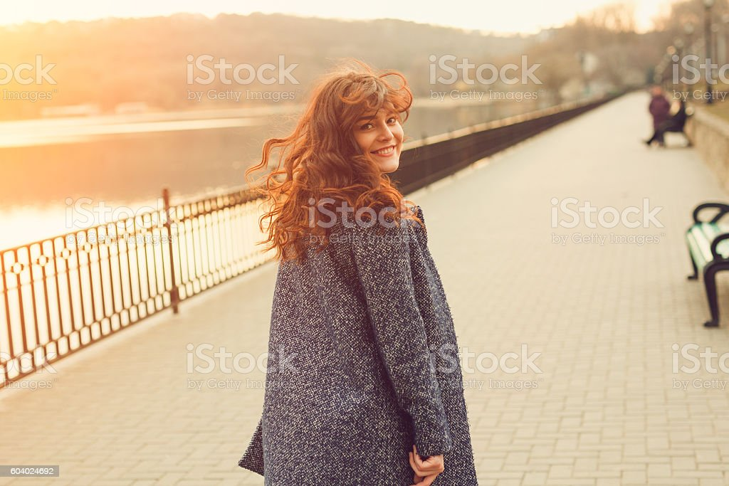 Happy overweight woman walking stock photo