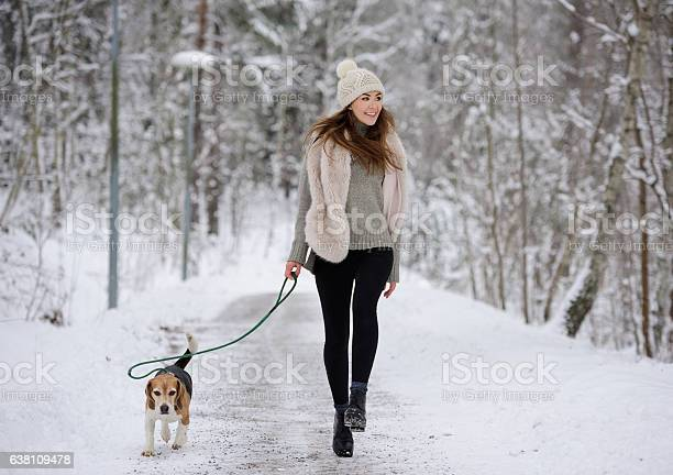 Happy woman walking running with beagle dog winter walk path picture id638109478?b=1&k=6&m=638109478&s=612x612&h=9jxcxxg70wjim 7x1v eql4 vc3uzftuprj07dzzpyw=