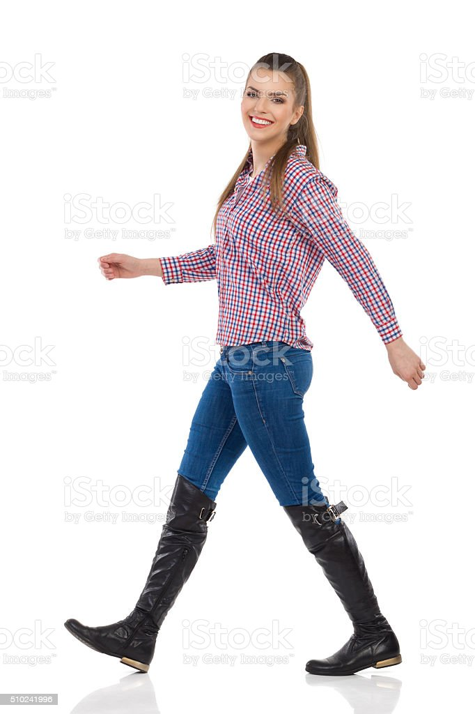 Happy Woman Walking Side View stock photo