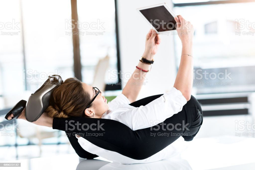 Happy woman watching at digital device stock photo