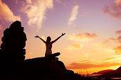 istock Happy woman watching beautiful sunset. 1098082294