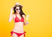 istock Happy woman wearing bikini and drinking  tropical cocktail 948490896