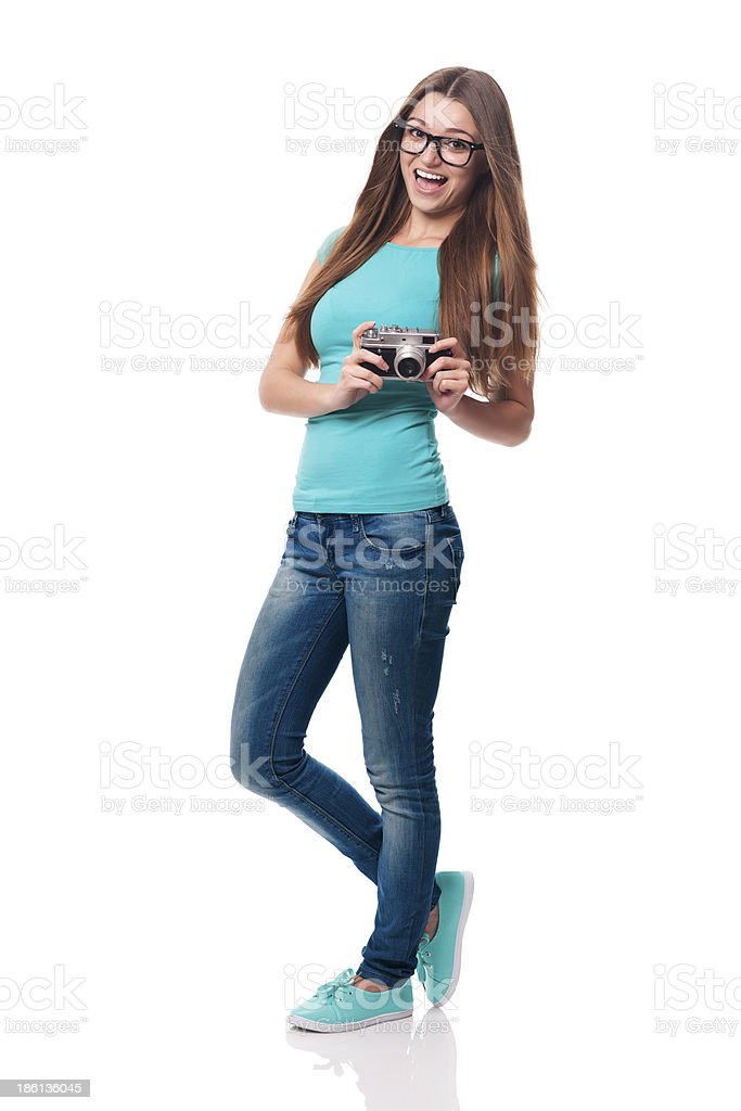 Happy woman wearing fashion glasses taking photo royalty-free stock photo