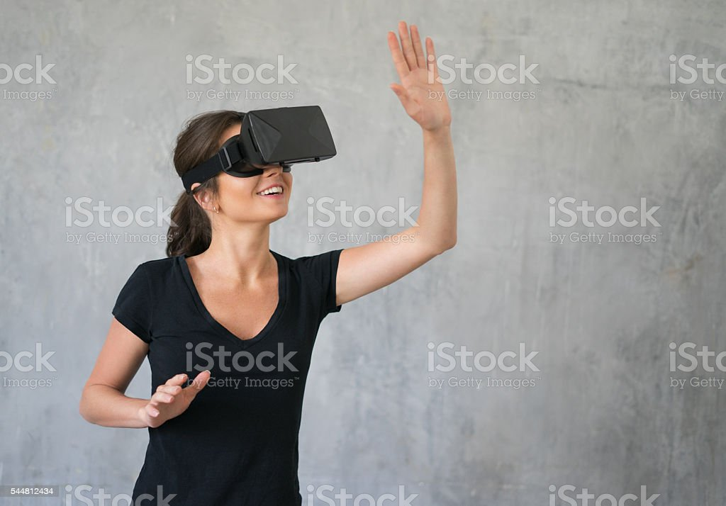Happy woman wearing VR Glasses stock photo